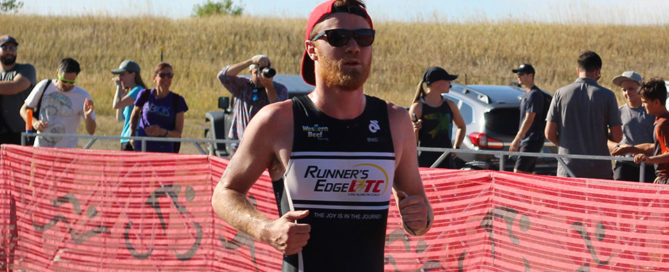 Matthew running during a triathlon